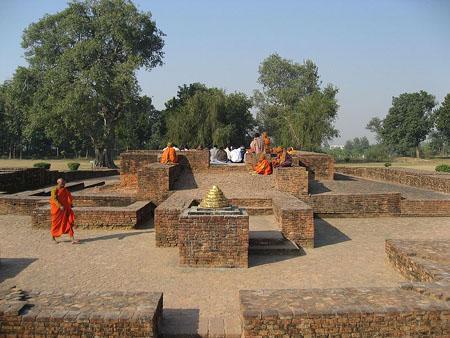 Scene in Jetavana, showing some small stupas.