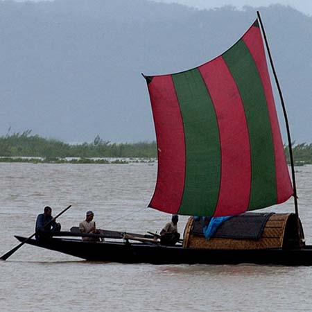 Fishermen on a country boat on the Brahmaputra
